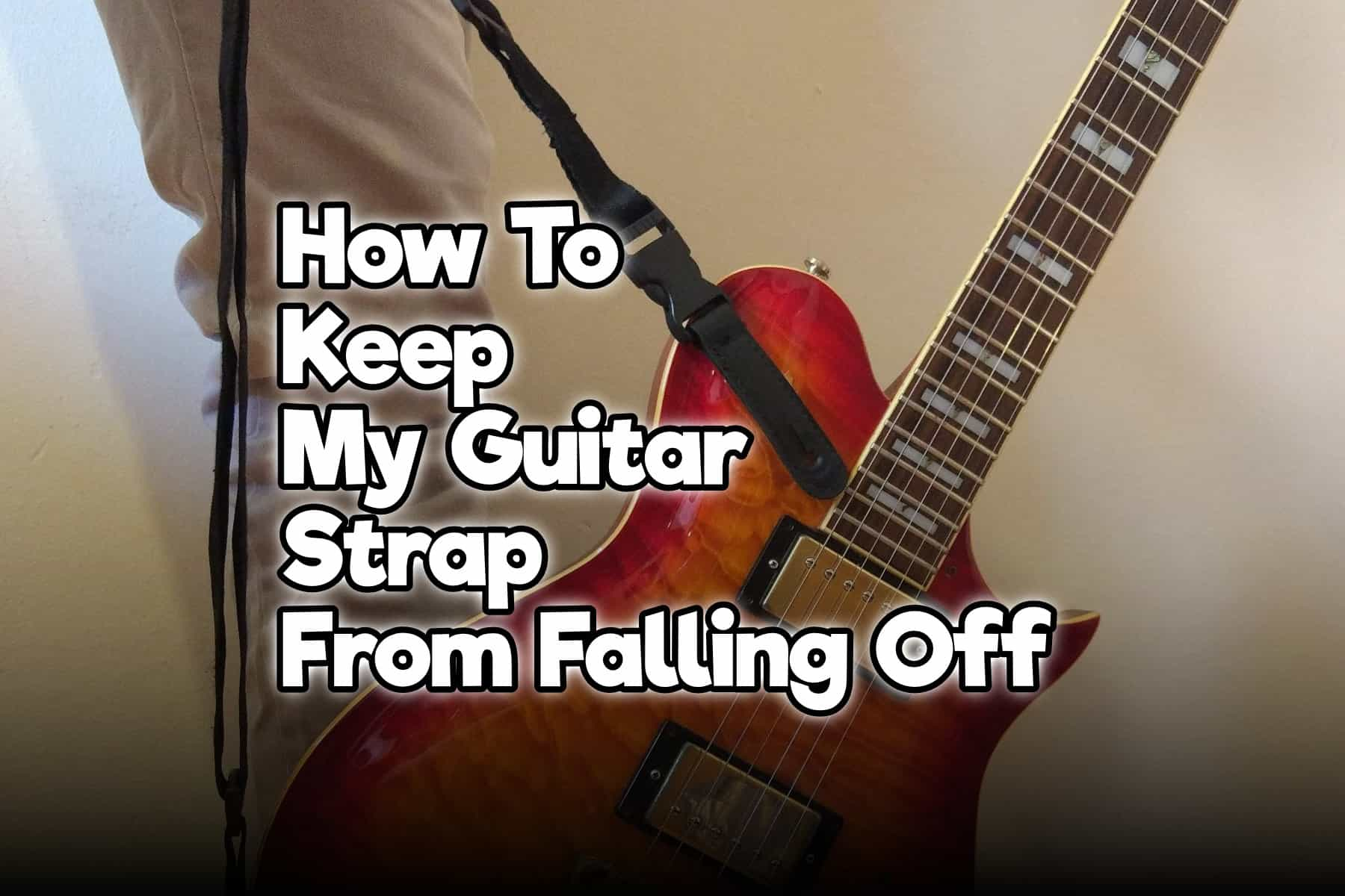 How To Keep My Guitar Strap From Falling Off Rock Guitar Universe